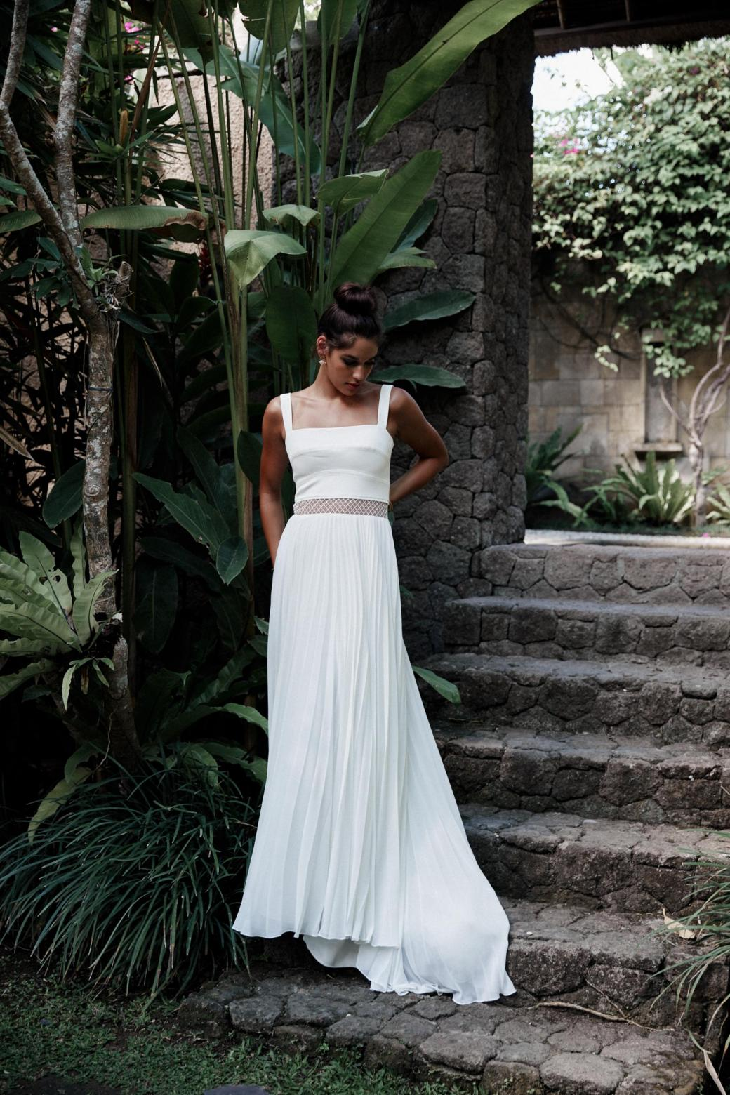 The Daisy gown by Karen Willis Holmes, flowy modified a-line wedding dress with square neckline.