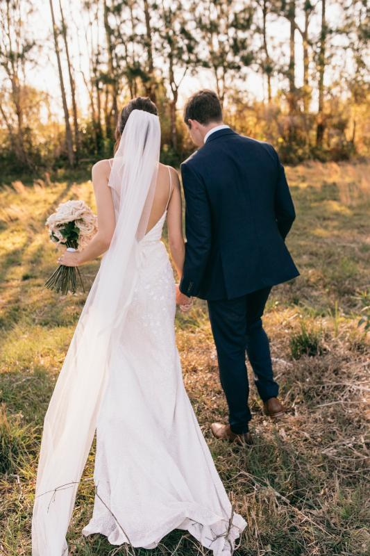 Real bride Renee wore the Luxe Darcy wedding dress by Karen Willis Holmes.