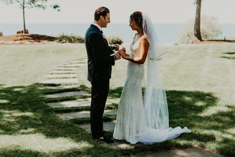 Real bride Jenna wore the Luxe Donna wedding dress by Karen Willis Holmes.