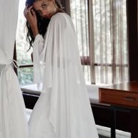 The Sylvia bridal cape by Karen Willis Holmes, modern wedding jacket.