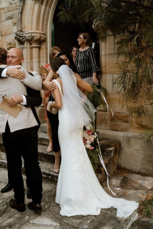 Real bride Alison wore the Wild Hearts Adina wedding dress by Karen Willis Holmes.