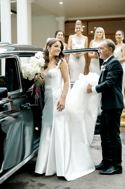 Real bride Erin wore the Bespoke Blake/Prea wedding dress by Karen Willis Holmes.