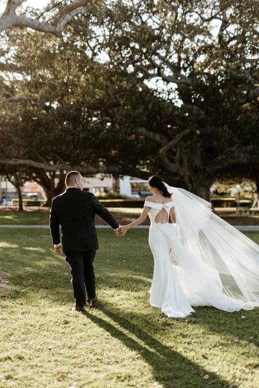 Real bride Melissa wore the Wild Hearts Lauren wedding dress by Karen Willis Holmes.