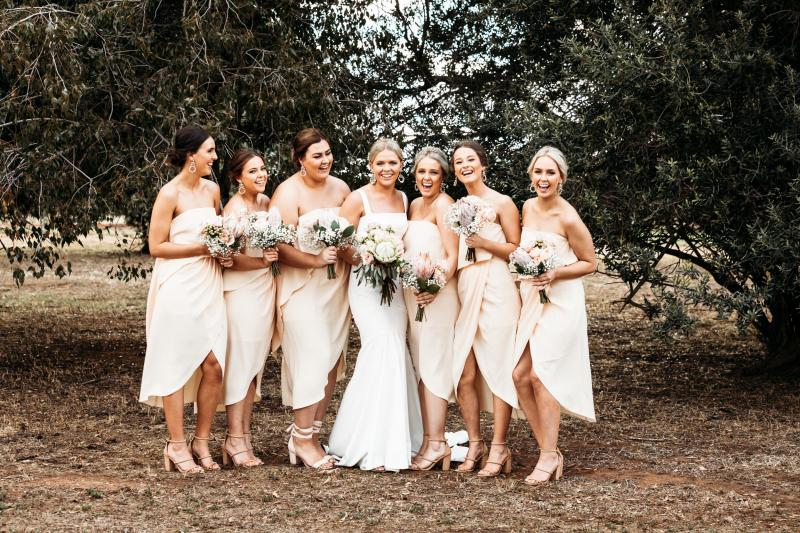 Real bride Tegan wore the Wild Hearts Violet wedding dress by Karen Willis Holmes.