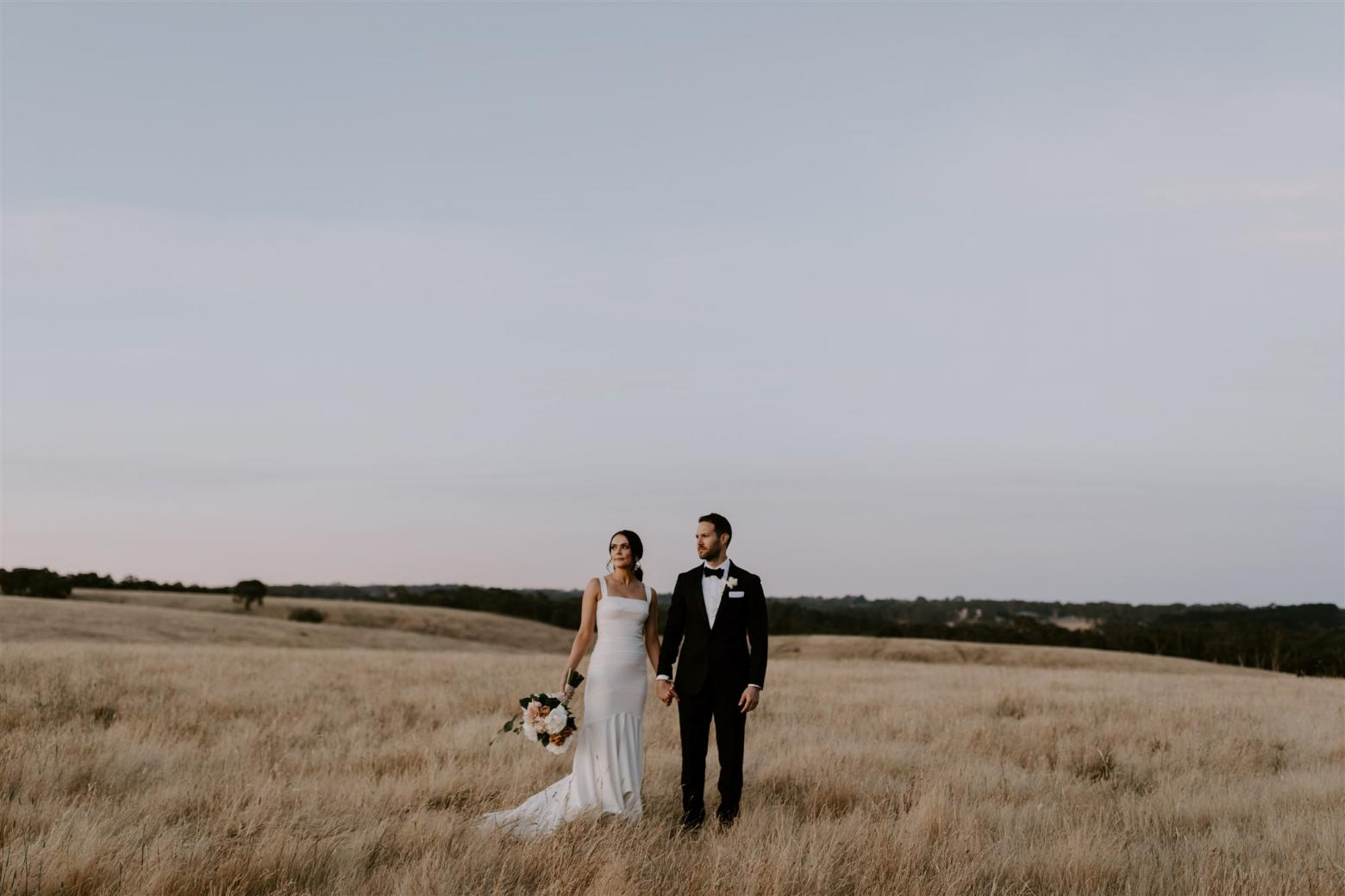 KWH bride Rachael and Adam in a picturesque field. Rachael wears the Violet gown.