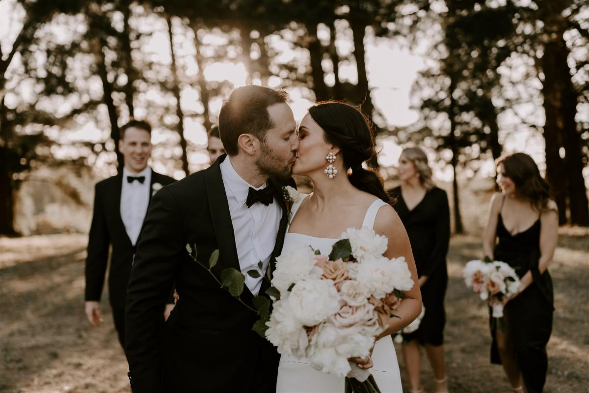KWH bride Rachael and Adam sharing a kiss. Rachael wears the timeless Violet gown.