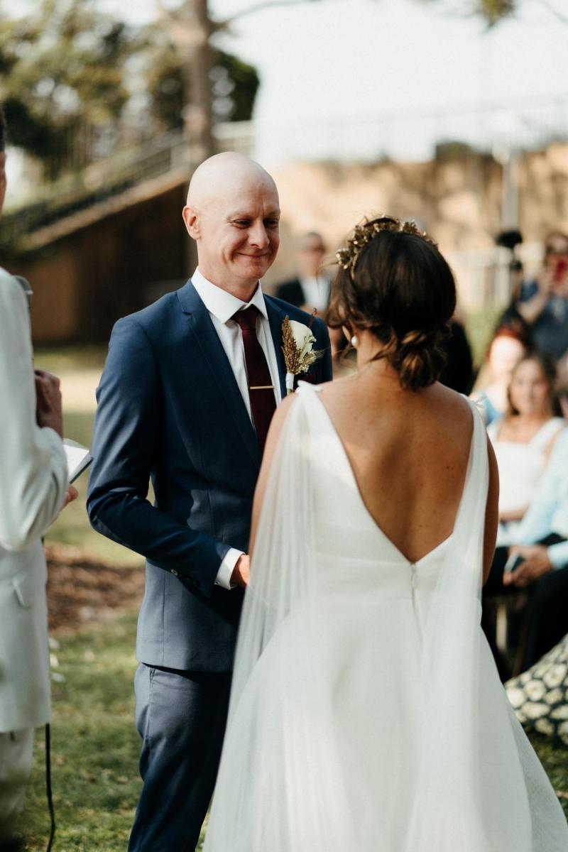 Bride and groom at Sydney wedding ceremony; bride wearing Aisha gown by Karen Willis Holmes