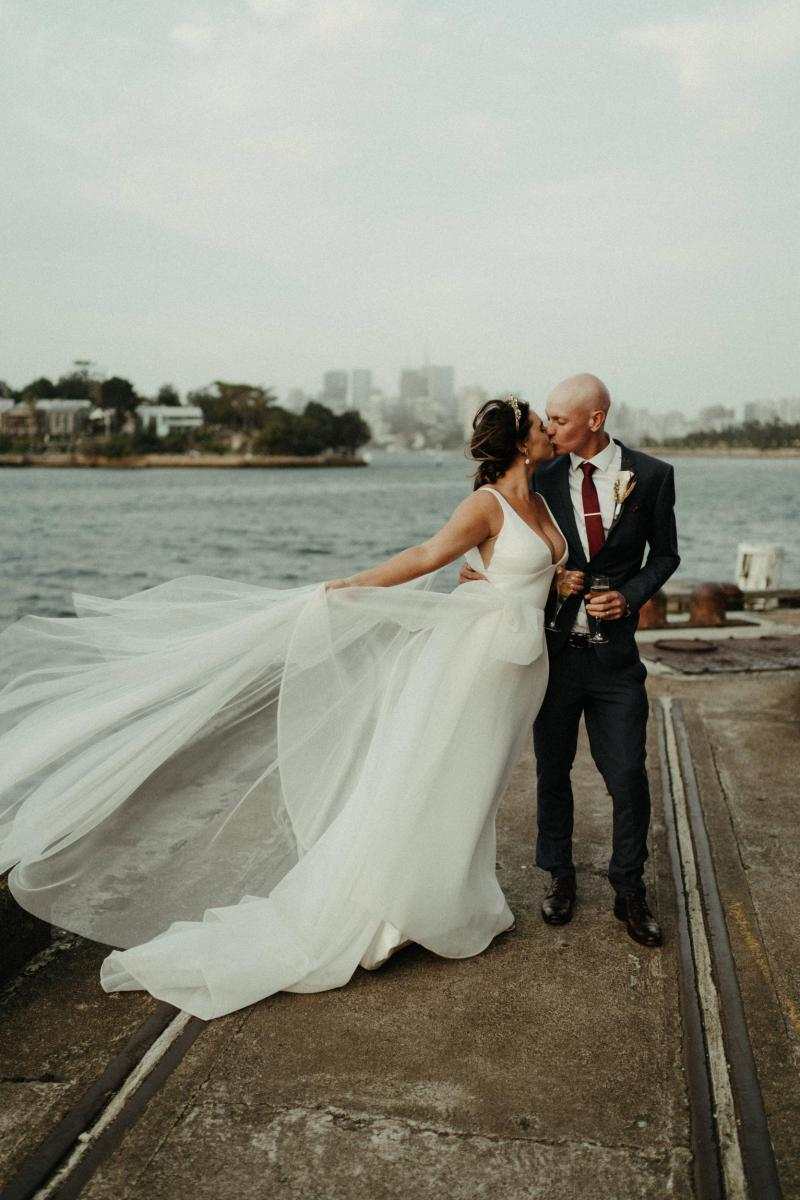 KWH bride and groom in Sydney Harbour, bride wearing AISHA wedding dress