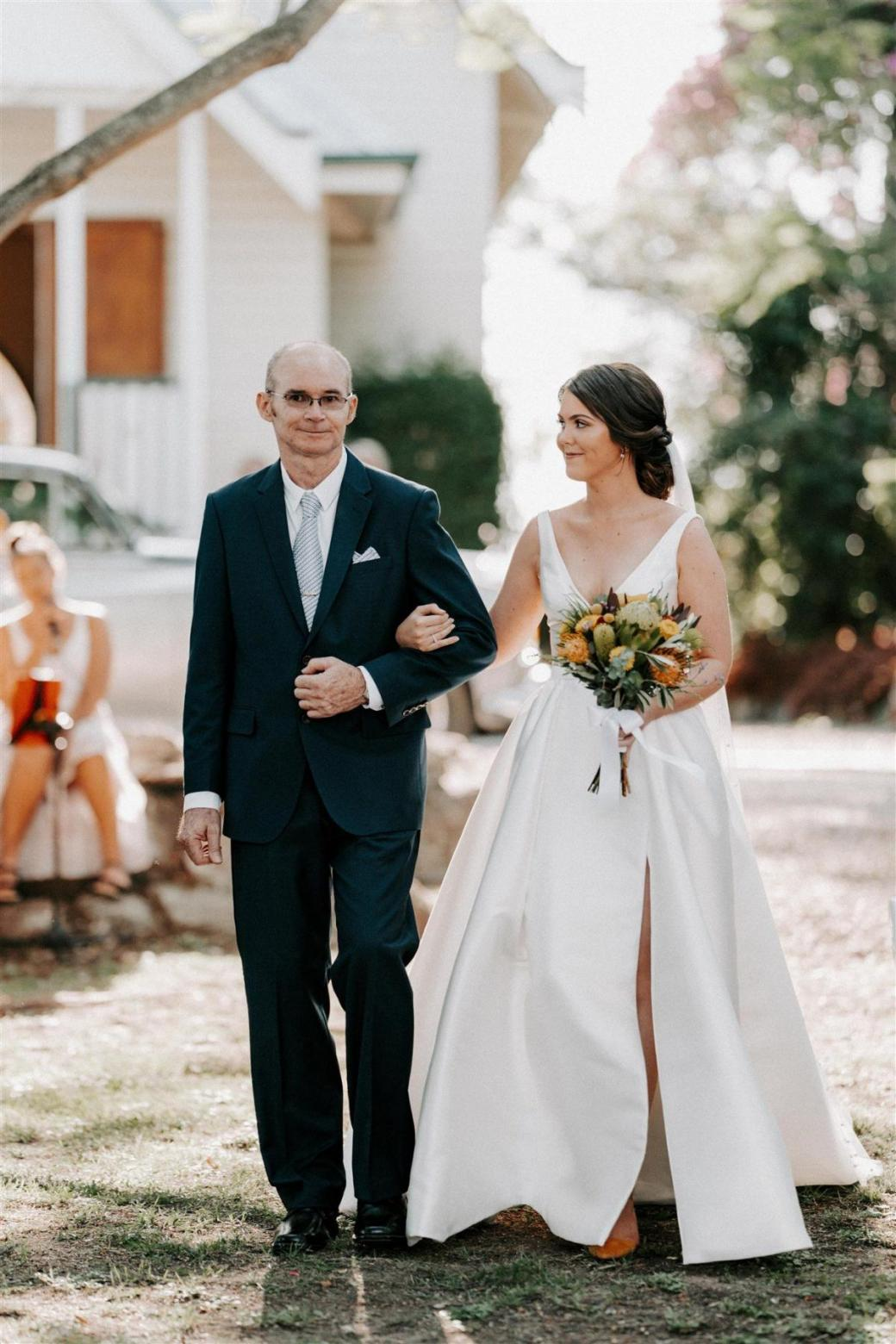 Real bride Alexandra wore the Bespoke Taryn/Camille wedding dress by Karen Willis Holmes.