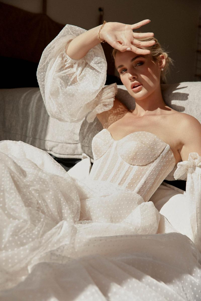 The Audrey gown by Karen Willis Holmes, a modern polka dot wedding dress, shown with detachable sleeves.