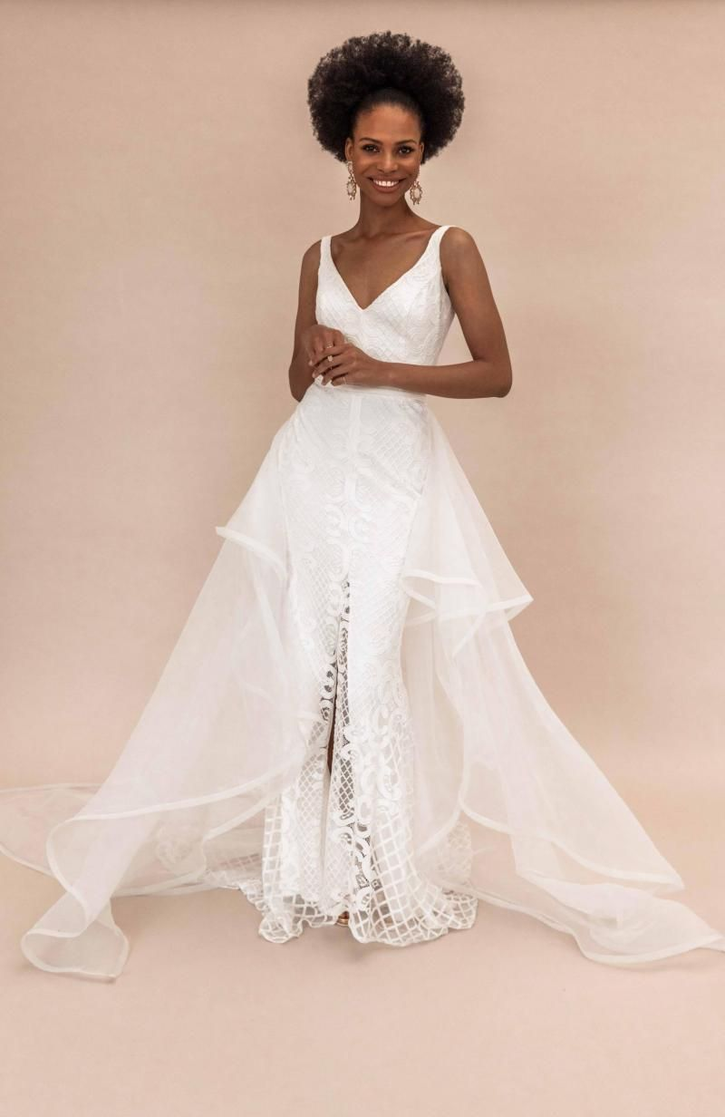 The Bobby gown by Karen Willis Holmes, modern lace wedding dress shown with detachable train.