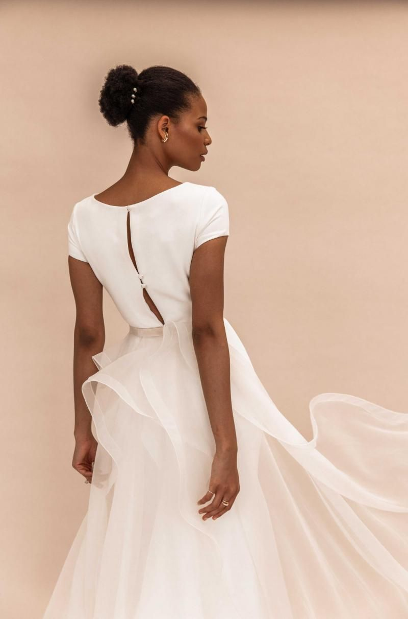 The Clarissa gown by Karen Willis Holmes, simple cap sleeve wedding dress with detachable skirt.