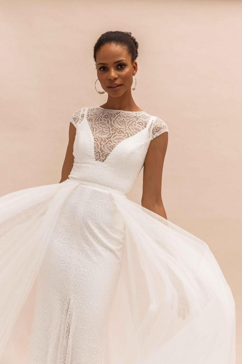 The Jemma gown by Karen Willis Holmes, cap sleeve illusion lace wedding dress shown with detachable skirt.