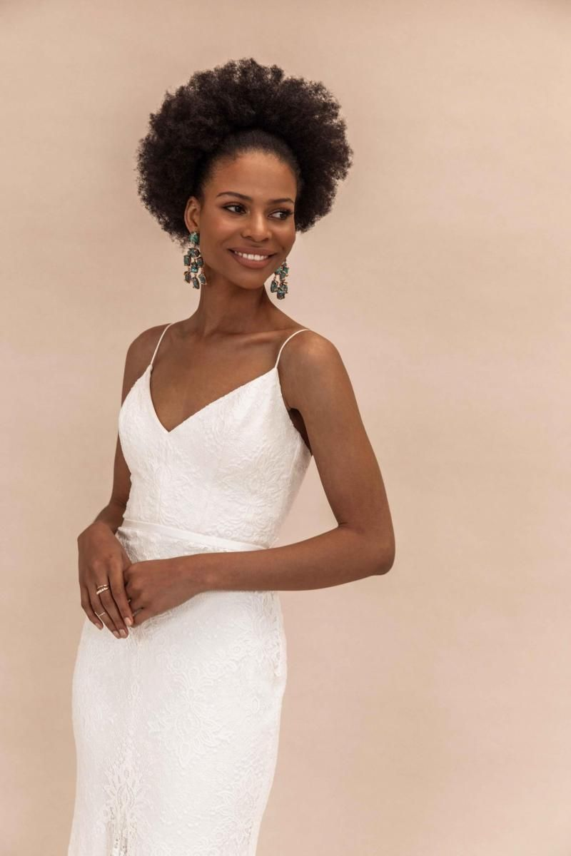 The Justine gown by Karen Willis Holmes, v-neck simple lace wedding dress.