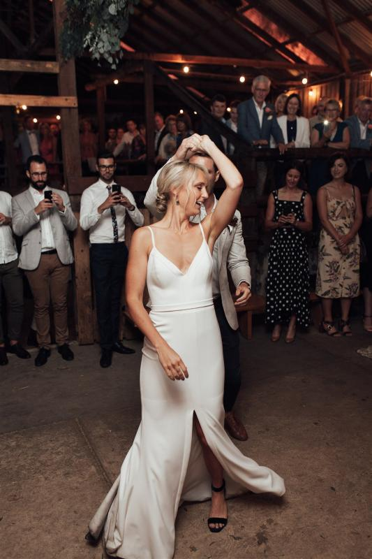 Real bride Lauren wore the Wild Hearts Caroline wedding dress by Karen Willis Holmes.