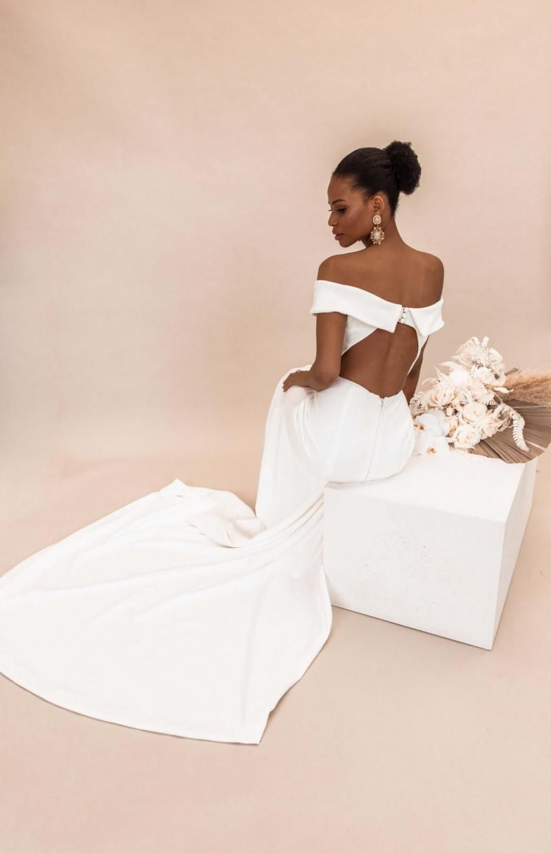 The Lauren gown by Karen Willis Holmes, open back off the shoulder wedding dress.