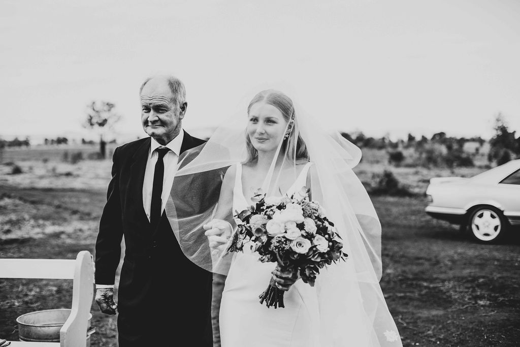 Real bride Chaseley wore the Bespoke Leonie/Alexia wedding dress by Karen Willis Holmes.
