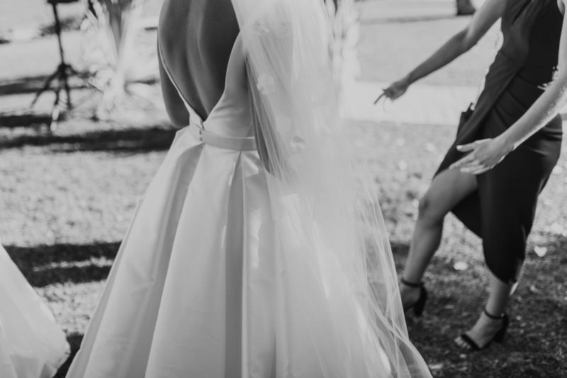 Kelsi wears the Leonie Melanie gown; a V-neck, A-line, simple wedding dress, for her Queensland wedding