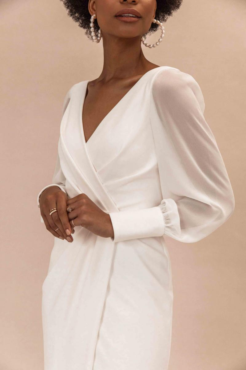 The Nikki gown by Karen Willis Holmes, simple wrap wedding dress with long sleeves.