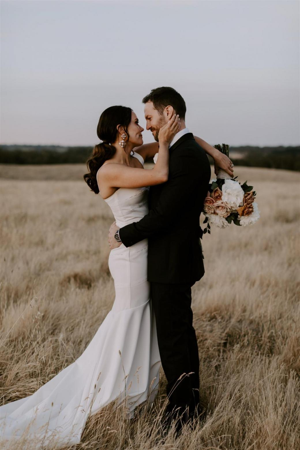 KWH bride Rachael and husband Adam sharing intimate moment. Rachael wears the minimal Violet gown.