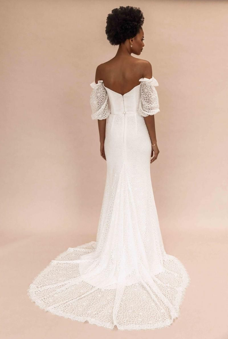 The Vivienne gown by Karen Willis Holmes, open back fit and flare lace wedding dress with puffy sleeves.