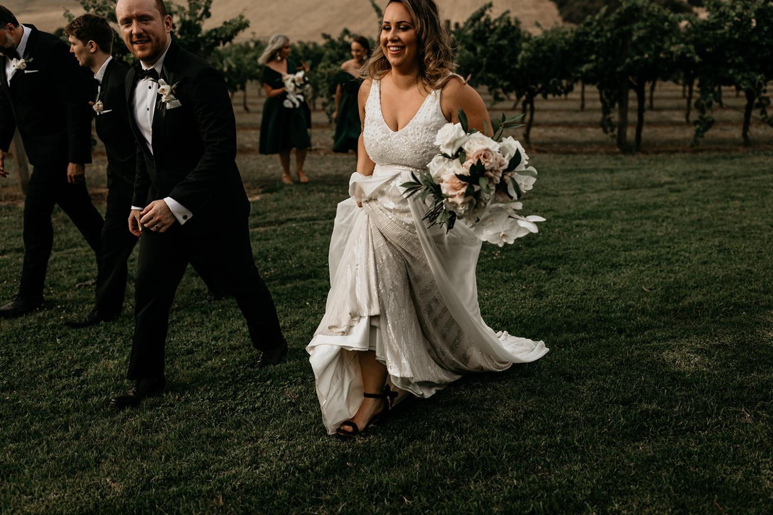 Real bride Liana wore the Luxe Fontanne wedding dress by Karen Willis Holmes.