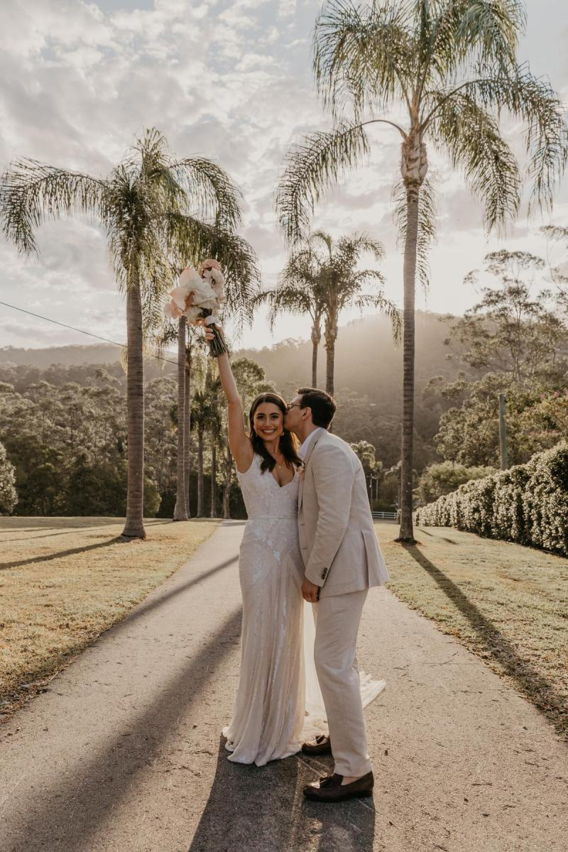 KWH bride Leah with new husband Sam, wearing the FONTANNE; a flattering beaded wedding dress with a V-neck and bias cut skirt.