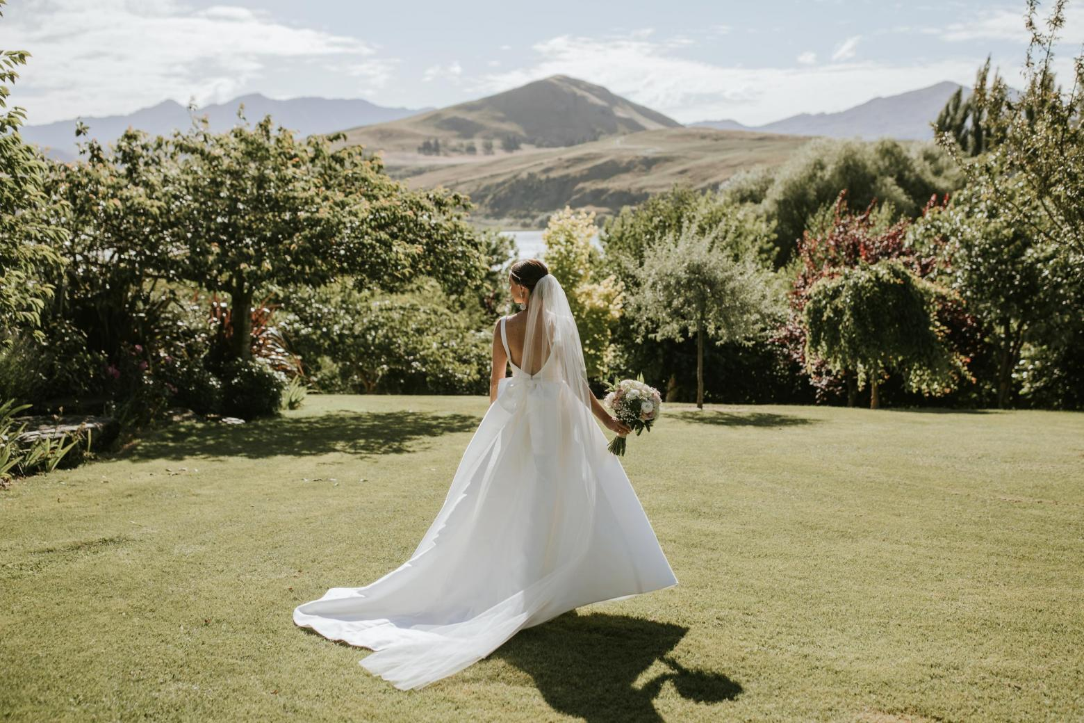 Real bride Madeleine wore the Bespoke Leonie/Camille wedding dress by Karen Willis Holmes.