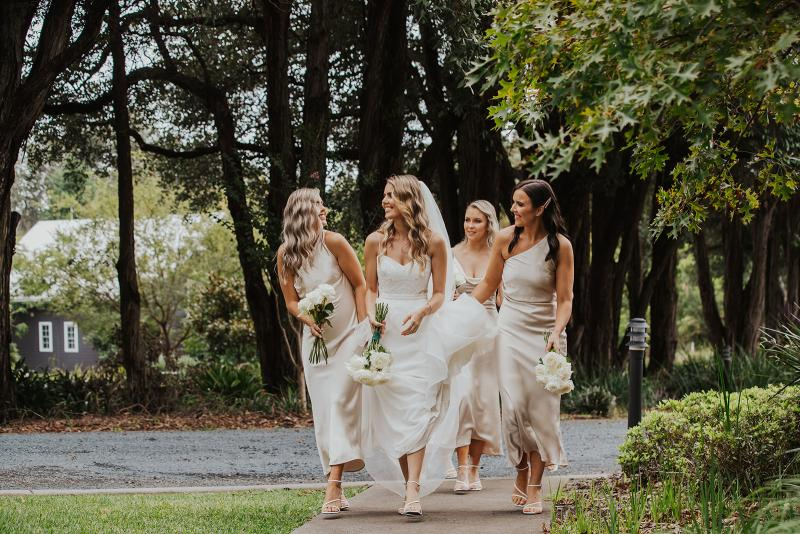 Bride and her bridesmaid's walking to ceremony in KWH