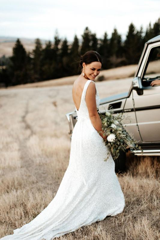 Real bride Louise wore the Luxe Anotinette wedding dress by Karen Willis Holmes.