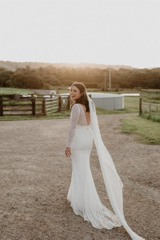 Real bride Charlotte wore the Wild Hearts Jemma wedding dress by Karen Willis Holmes.