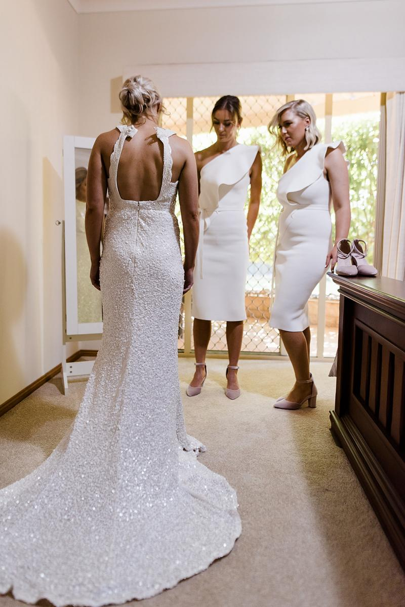 Real bride Laura wore the Luxe Cindy wedding dress by Karen Willis Holmes.