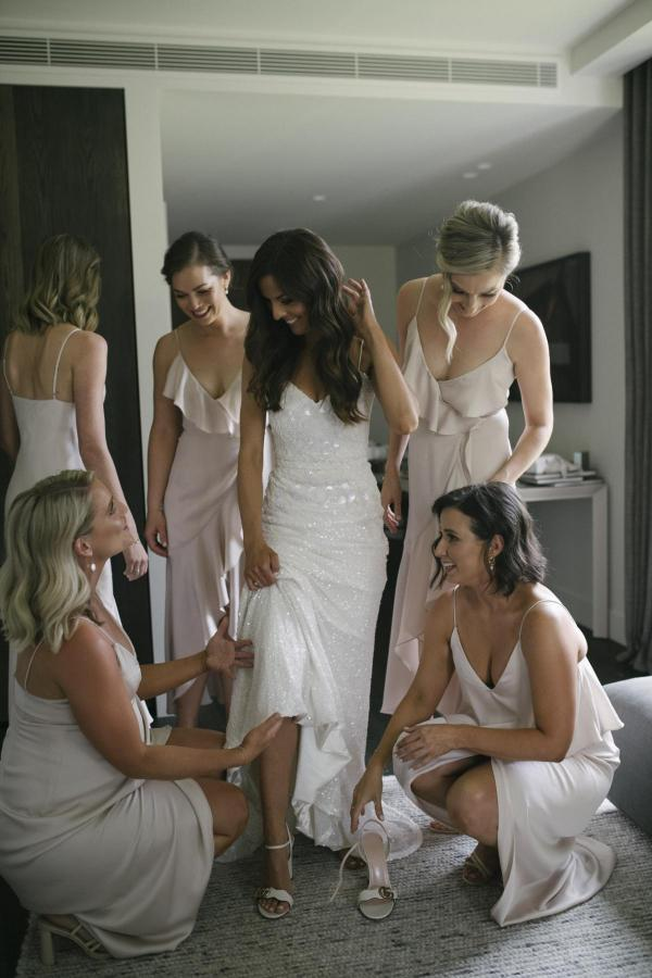 KWH brida in Darcy wedding dress getting ready with bridesmaids