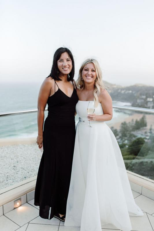 KWH bride Celeste with wedding guest, wearing the strapless ESTHER wedding dress by Karen Willis Holmes.