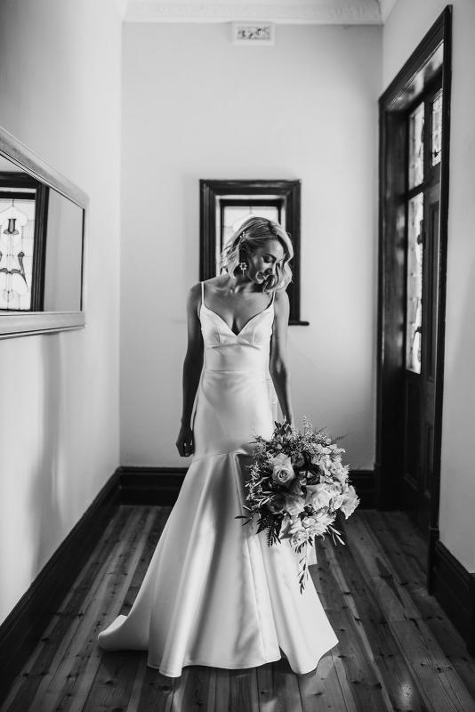 Brie wears Bespoke Jessie Catriona; a simple, dramatic wedding dress by Karen Willis Holmes