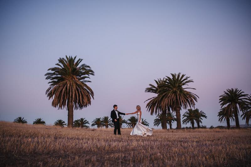 Brie wears Bespoke Jessie Catriona; a simple, dramatic wedding dress by Karen Willis Holme; field back drop