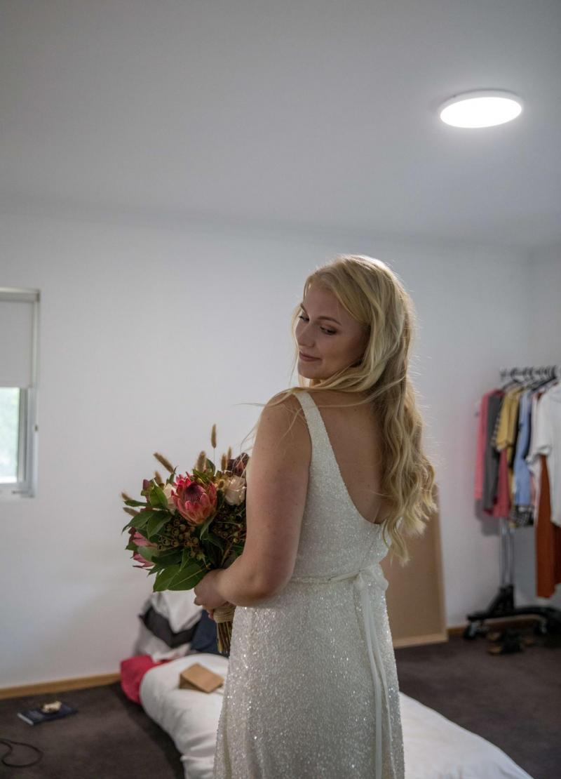 KWH bride getting ready for her COVID-19 wedding