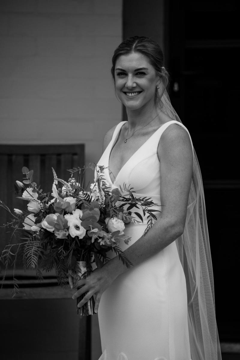 Olivia wears Tatiana; a simple V-neck wedding dress by Karen Willis Holmes