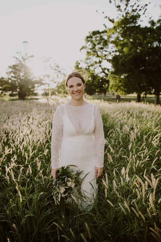 KWH bride Cassie celebrating real wedding in the JEMMA gown; a long sleeve lace wedding dress with lace sleeves.
