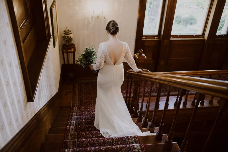 Real bride Cassie wears the Jemma gown by Karen Willis Holmes.