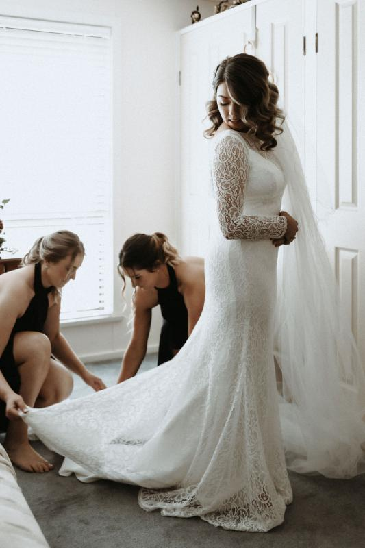 Karen Willis Holmes bride Meagan getting reading with her bridesmaids, the Wild Hearts Karina gown; a flattering long-sleeved lace wedding dress for the modern bohemian bride.