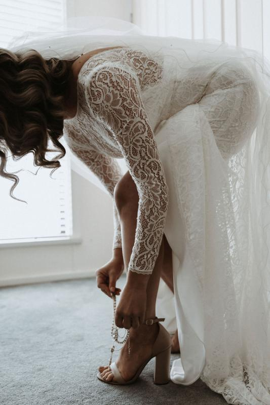 Karen Willis Holmes bride Meagan wearing the Wild Hearts Karina gown; a flattering long-sleeved lace wedding dress for the modern bohemian bride.