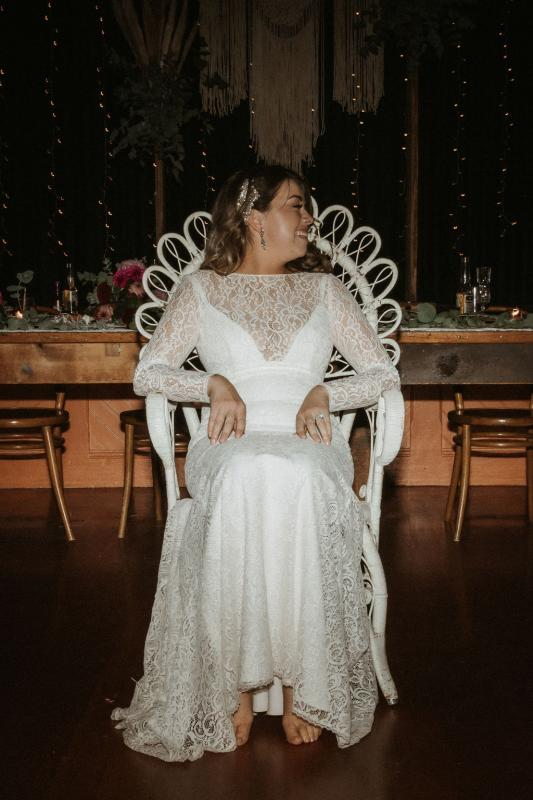 Karen Willis Holmes bride Meagan wearing the Karina gown to her real pub wedding reception; a long-sleeve lace wedding dress from the Wild Hearts Collection.