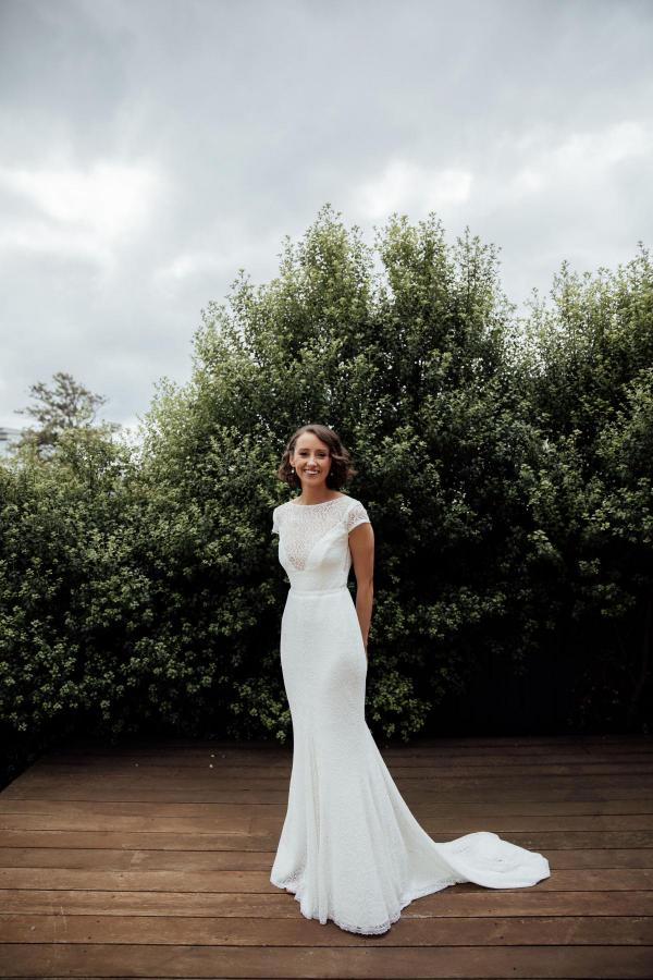 Real bride Amy wears the Wild Heart's Jemma gown by Karen Willis Holmes; with a sheer bodice and figure hugging skirt.