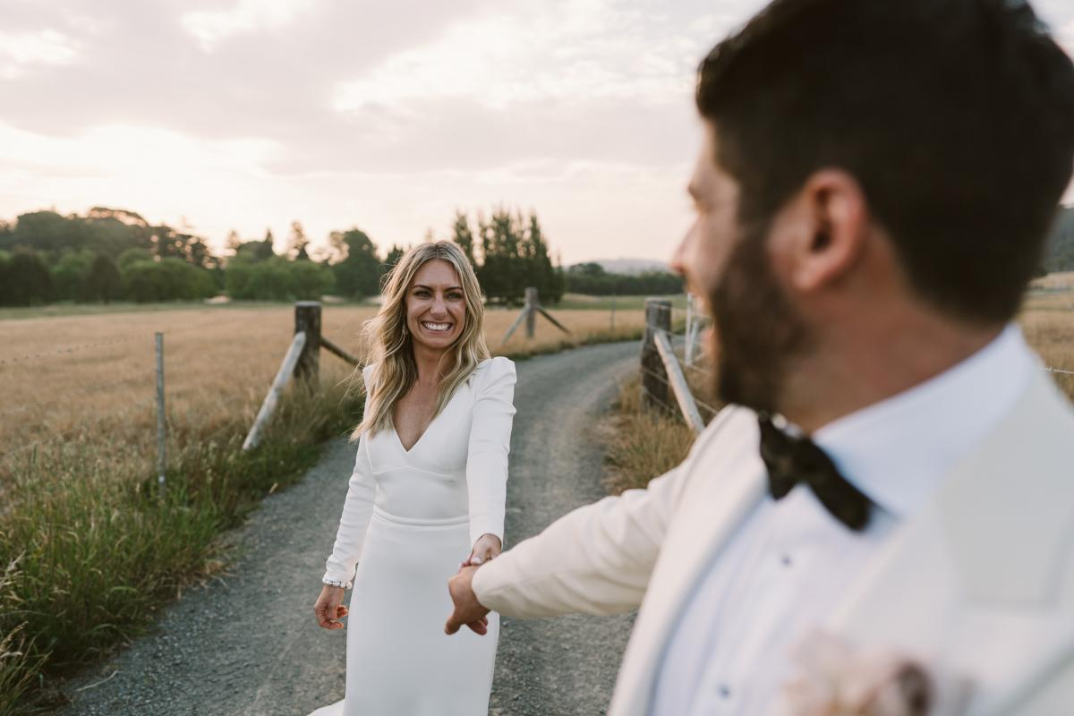 KWH bride Annabelle wearing the timeless Aubrey gown; a simple long sleeve wedding dress with a dramatic train.