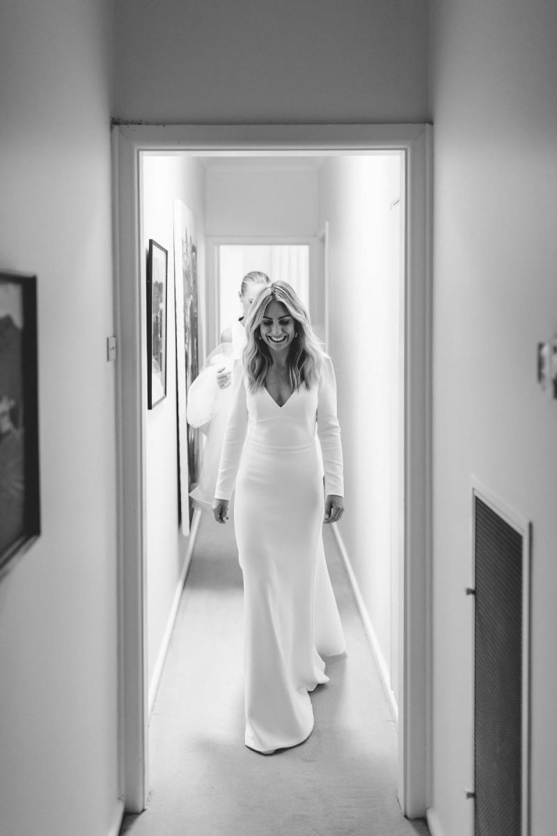 Real bride Annabelle wears the Aubrey gown; a simple long-sleeved wedding dress from the Wild Hearts Collection, designed by Karen Willis Holmes.