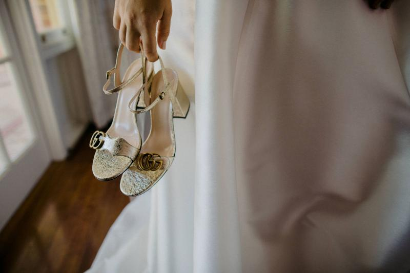 KWH bride Hannah getting ready for black tie wedding; wearing Gucci gold heels as wedding shoes.