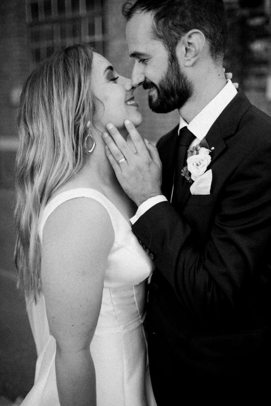 KWH bride Hannah kissing husband Dan after juust being married, wearing the Bespoke Taryn nina gown.