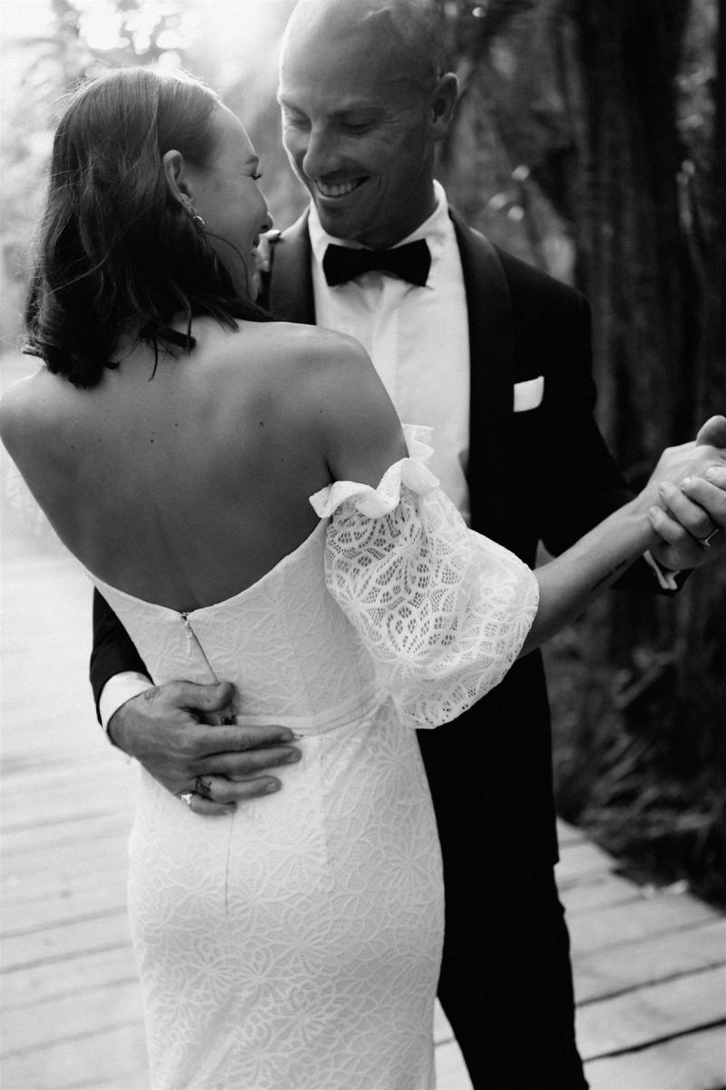 Bride wears Wild Hearts made to order lace off the shoulder Vivienne gown by Karen Willis Holmes