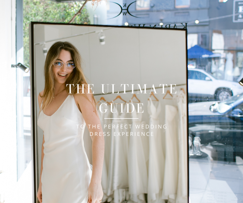 The ultimate dress shopping guide - Bride trying on minimal bias silk slip dress in Karen Willis Holmes wedding dress boutique